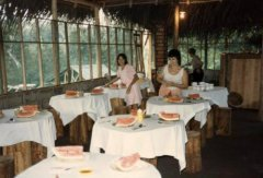 Original dining room with tables and stools made from salvaged tree trunks, c. 1986.jpg